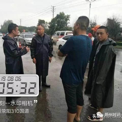 �铌�市公路管理局暴雨中公路人的�任�c����
