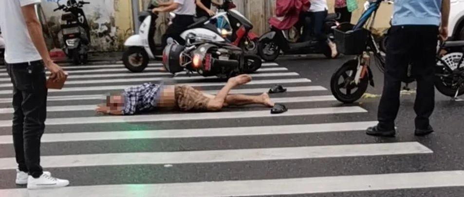 揭西一红绿灯路口发生交通事故,一男子躺在斑马线上……