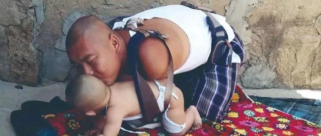 孩子,爸爸�]有�p手,依然可以抱你�L大!