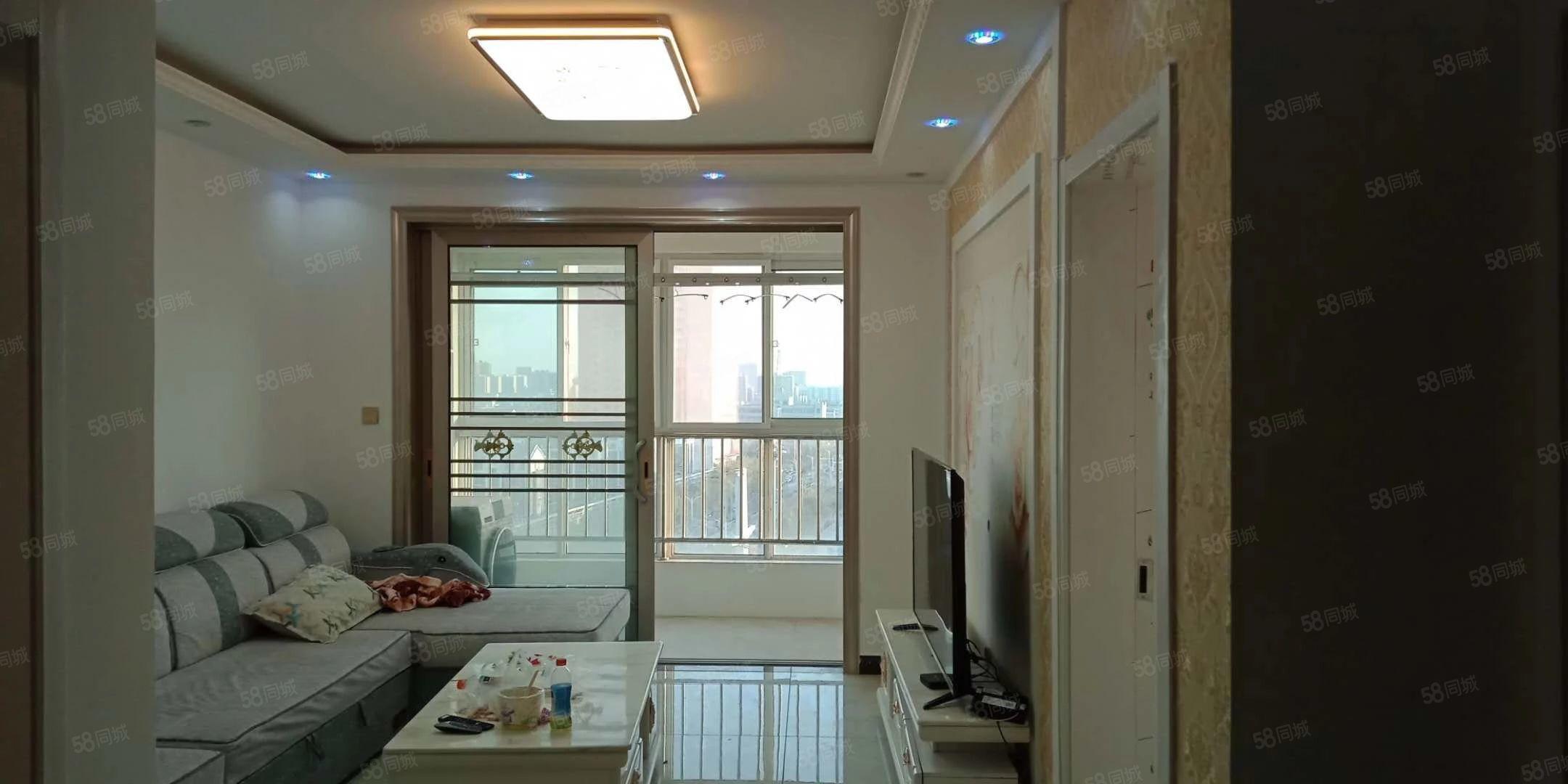 出售金色阳光12楼91平精装2室2厅带家电家具,39万价可议